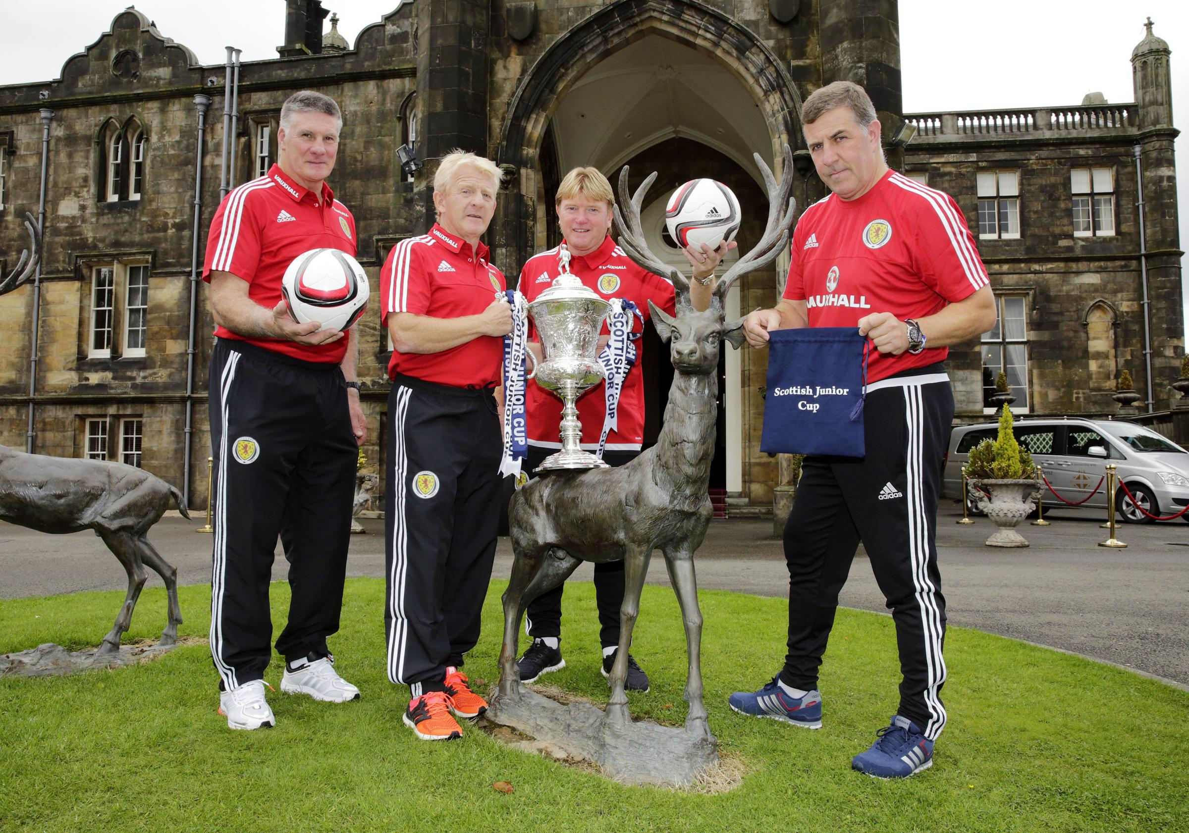 Scotland manager Gordon Strachan and his backroom staff Jim Stewart, Stuart McCall and Mark McGhee  made the Scottish Junior Cup second round draw at Mar Hall yesterday