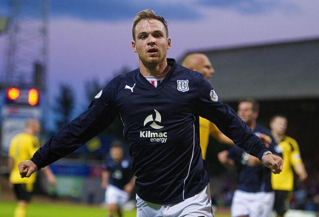 Carlo Monti celebrates scoring against Livingston during his spell at Dundee in 2013