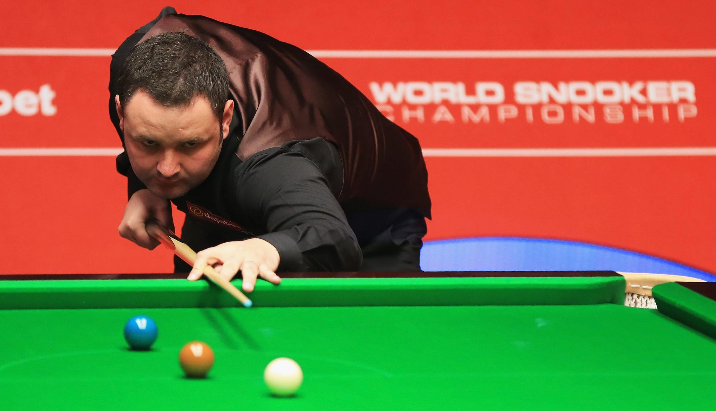 SHEFFIELD, ENGLAND - APRIL 19:  Stephen Maguire of Scotland in action against Ryan Day of Wales during day one of the The Dafabet World Snooker Championship at Crucible Theatre on April 19, 2014 in Sheffield, England.  (Photo by Matthew Lewis/Getty Images