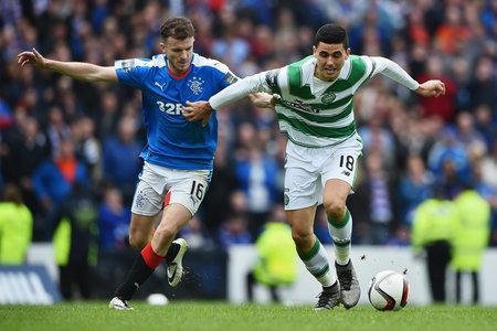 Evening Times: Andy Halliday had a superb game at Hampden as here he keeps tabs on Tom Rogic