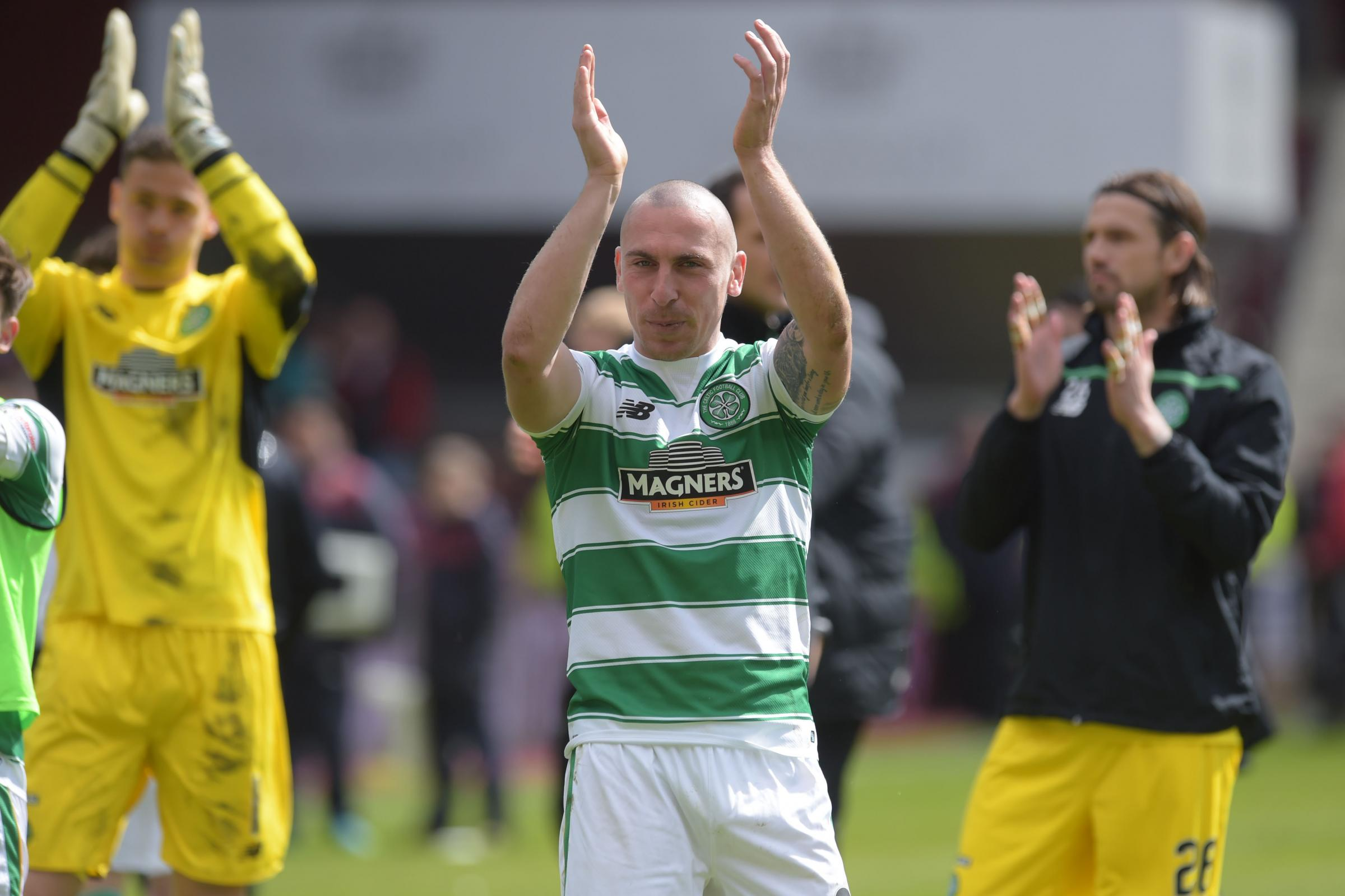 Celtic's Scott Brown celebrates after clinching the title on Saturday