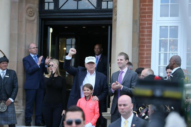 Donald Trump tackles media circus and prankster at Turnberry opening ... a6e0b38ac311