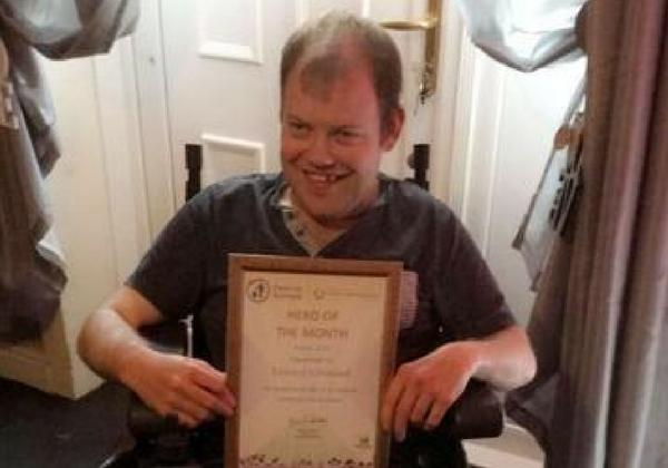 Man who cleans up Glasgow streets for free in his wheelchair receives award