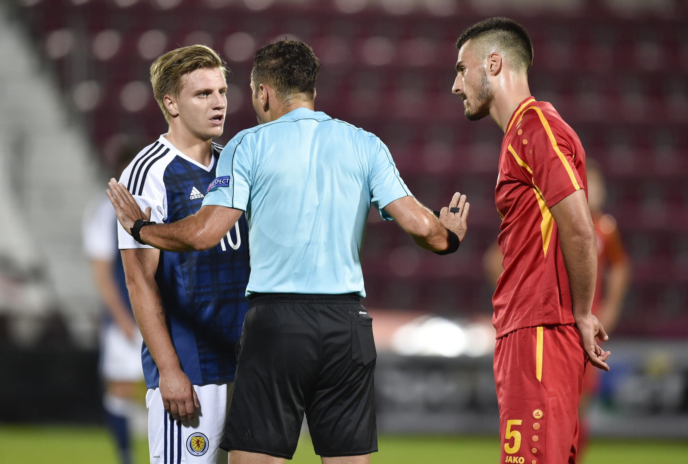 02/09/16 UEFA EUROPEAN U21 CHAMPIONSHIPS QUALIFIER .  SCOTLAND U21 v MACEDONIA U21 .  TYNECASTLE - EDINBURGH .  Scotland's Jason Cummings (left) is spoken to by the referee.