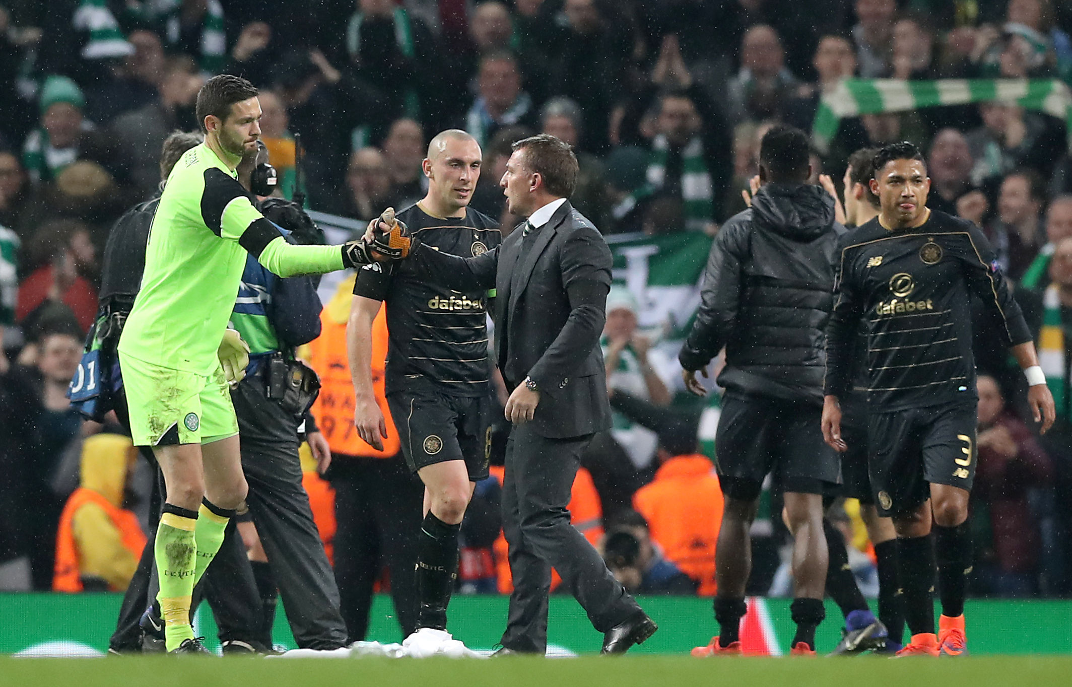 Brendan Rodgers shakes the hand of Celtic goalkeeper Craig Gordon after the final whistle against Manchester City.