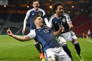 26/03/17 FIFA WORLD CUP QUALIFYING . SCOTLAND v SLOVENIA . HAMPDEN PARK - GLASGOW . Scotland's Chris Martin celebrates his late goal with his team-mates.