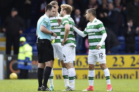 Evening Times: Stuart Armstrong appeals to referee Don Robertson after the whistler awarded a penalty against the Parkhead side