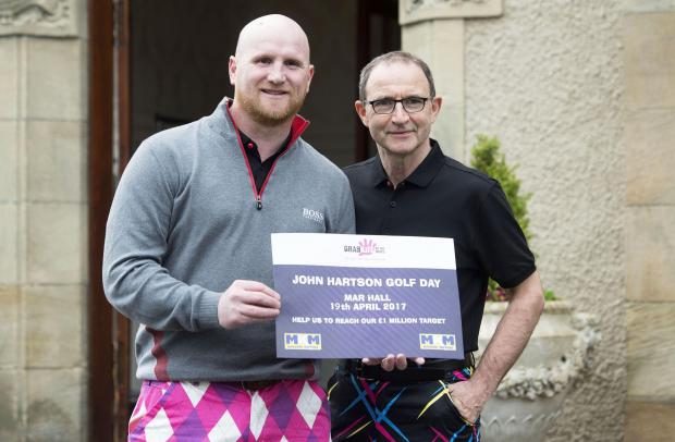 Evening Times: Former Celtic star John Hartson and manager Martin O'Neil is on hand at his annual golf day to promote the John Hartson Foundation's testicular cancer awareness campaign.