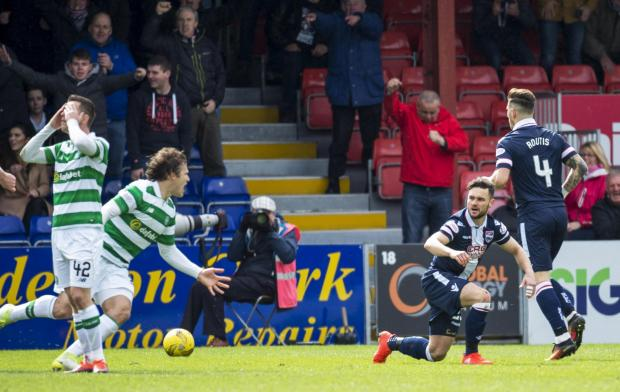 Evening Times: 16/04/17 LADBROKES PREMIERSHIP. ROSS COUNTY V CELTIC. GLOBAL ENERGY STADIUM - DINGWALL. Ross County's Alex Schalk (R) rises after going down in the box.
