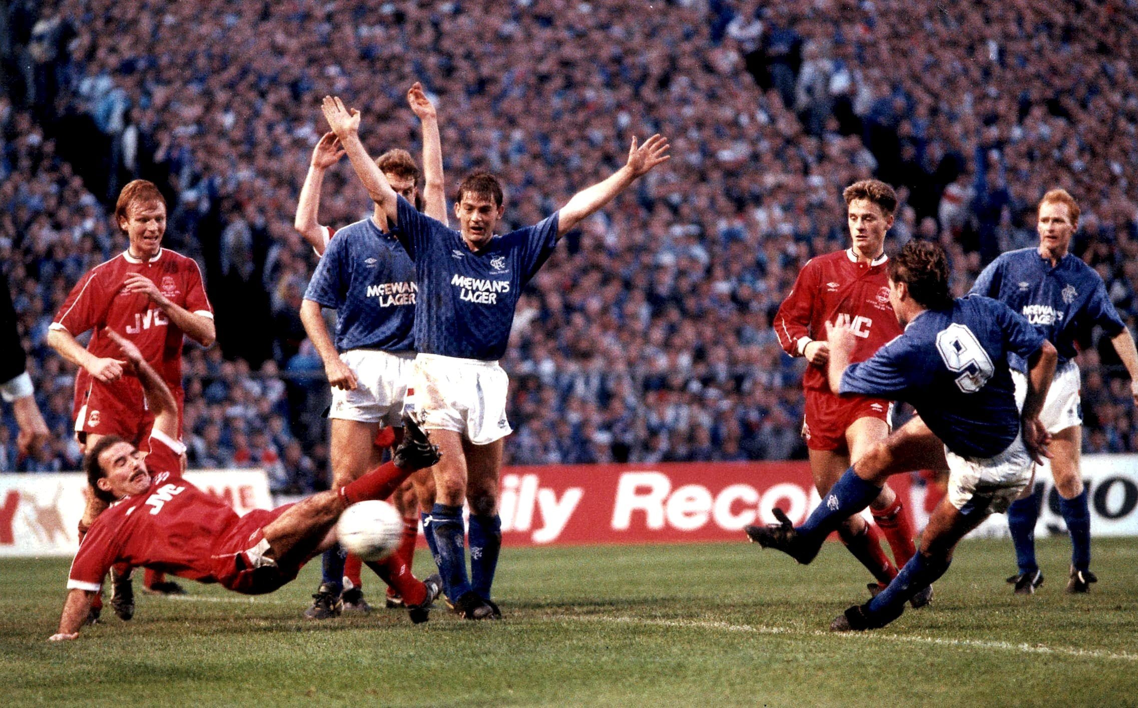 Ally McCoist fires home Rangers' winning goal in their 3-2 League Cup Final win over Aberdeen in 1988