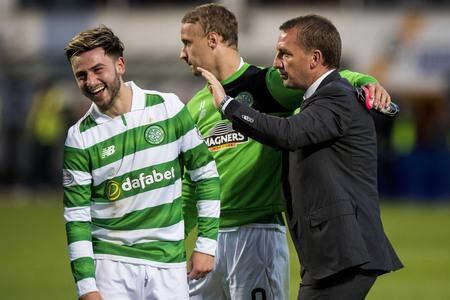 Evening Times: Celtic manager Brendan Rodgers embraces Patrick Roberts
