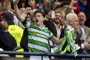 Celtic's Kieran Tierney lifts the Scottish Cup.