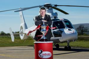 SPFL chief executive Neil Doncaster with the Ladbrokes League 2 trophy
