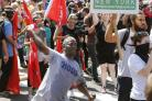 Murder charge after car hits counter-demo crowd at white supremacist rally
