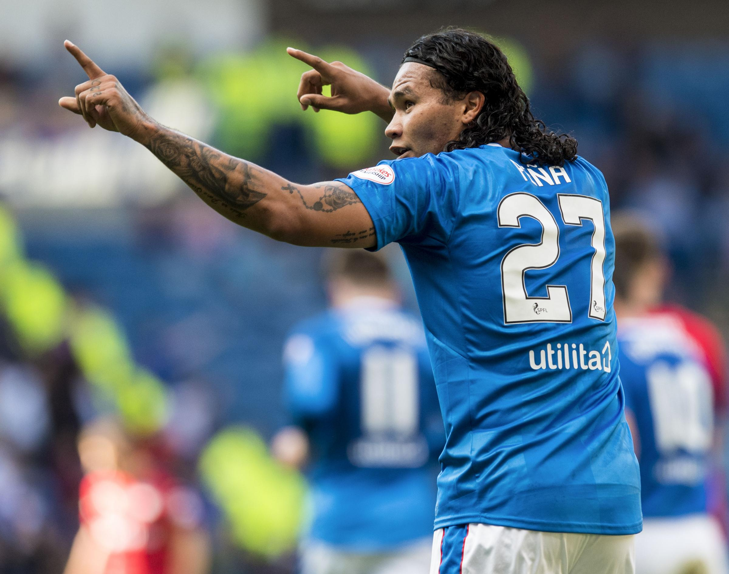 Carlos Pena celebrates his goal against Dundee