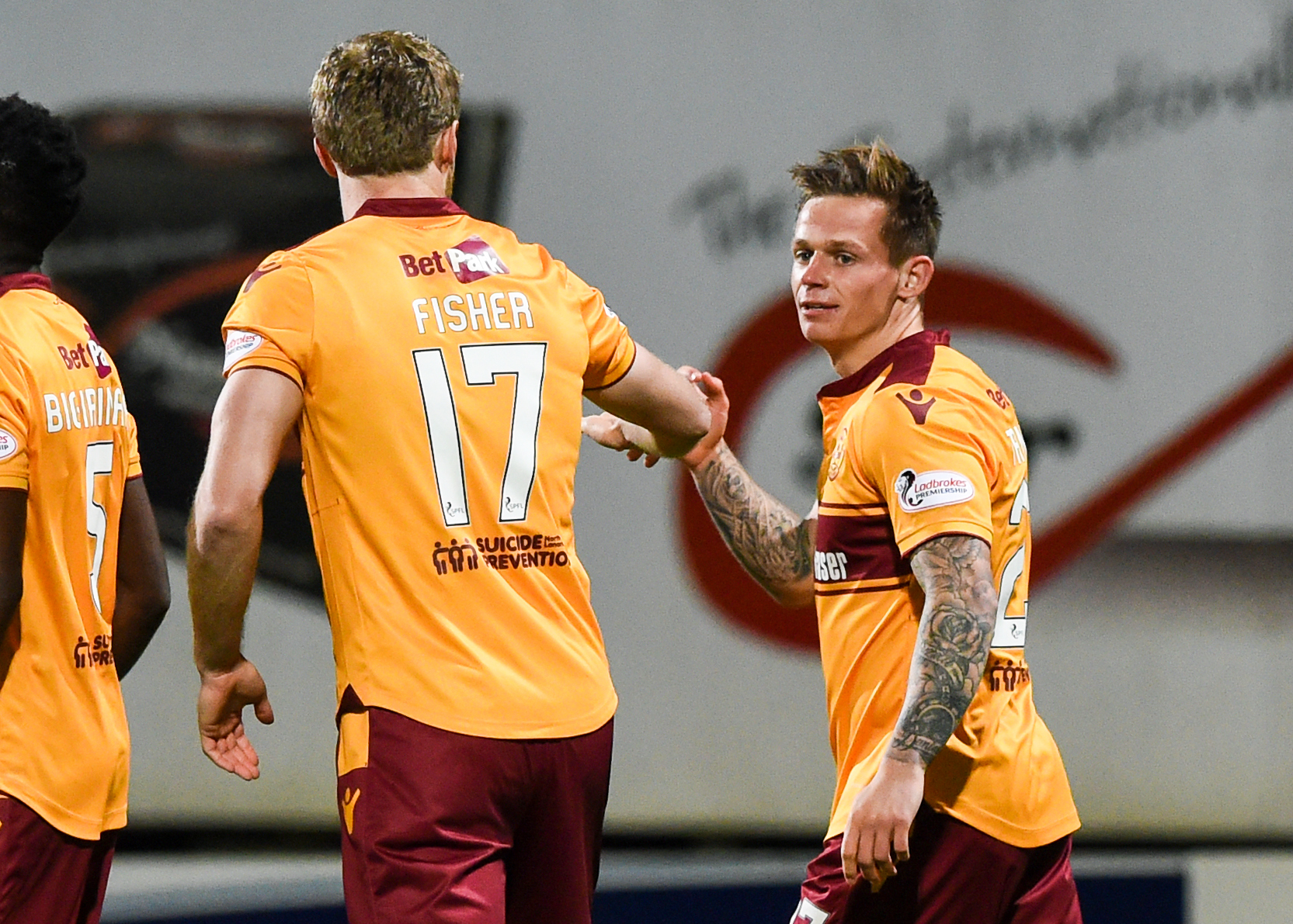 Craig Tanner celebrates with Alex Fisher after hitting the only goal of the game for Motherwell.