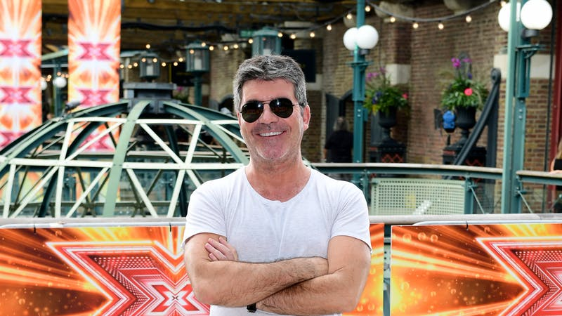 Simon Cowell returns home after reported fall down stairs