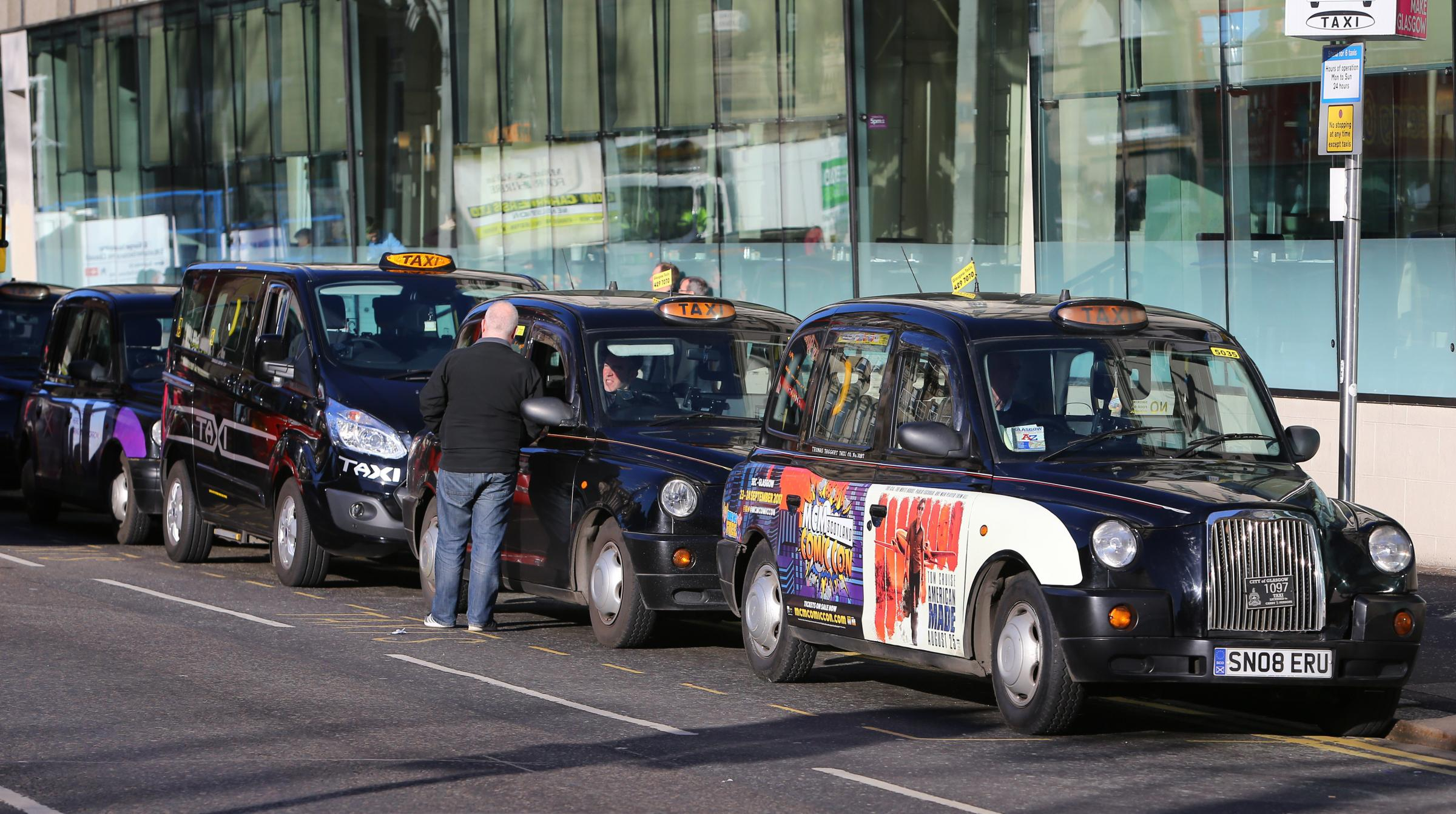 Black Hackney taxis pictured at their taxi rank on West George street outside the Millennium hotel...   Photograph by Colin Mearns.27 October 2017.