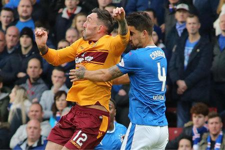 Evening Times: Rangers defender Fabio Cardoso picked up a broken nose following a challenge with Motherwell's Ryan Bowman during the Betfred Cup Semi Final at Hampden Park.