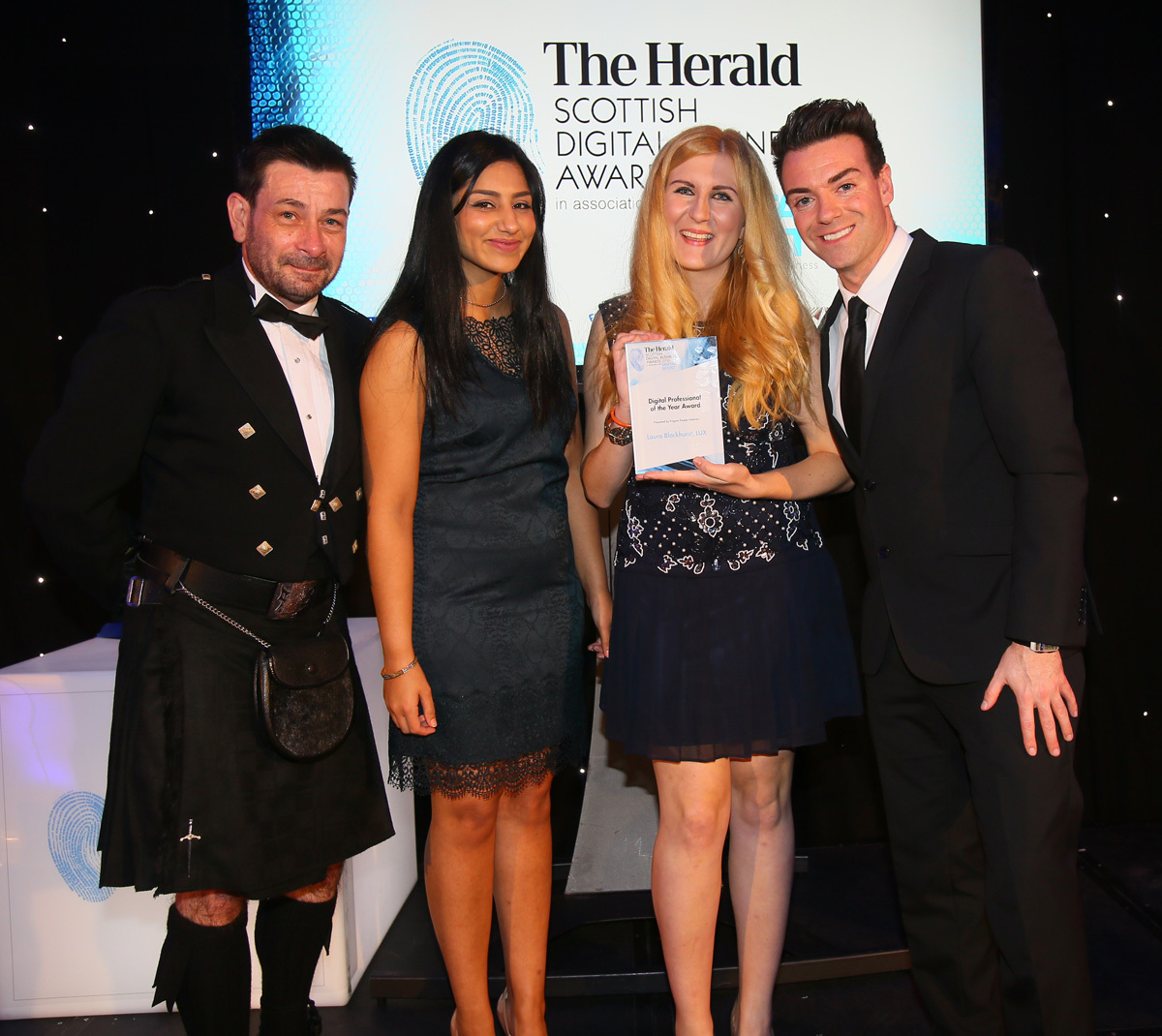 The Herald Scottish Digital Business awards 2016, Radisson Blu Hotel, Glasgow. Winner of the Digital Professional of the Year Award is  Laura Blackhurst of LUX. Presenting the award are David Mains and Anndeep Sandhu, both of Enigma People Solutions and h