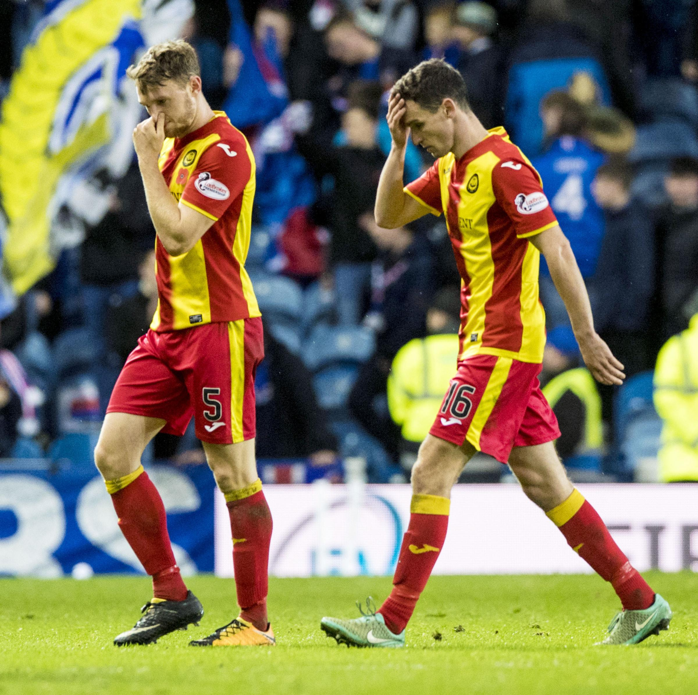 04/11/17 LADBROKES PREMIERSHIP. RANGERS V PARTICK THISTLE (3-0) (3-0). IBROX - GLASGOW. Partick Thistle's Paul McGinn (right) and Niall Keown trudge off the pitch at full time.