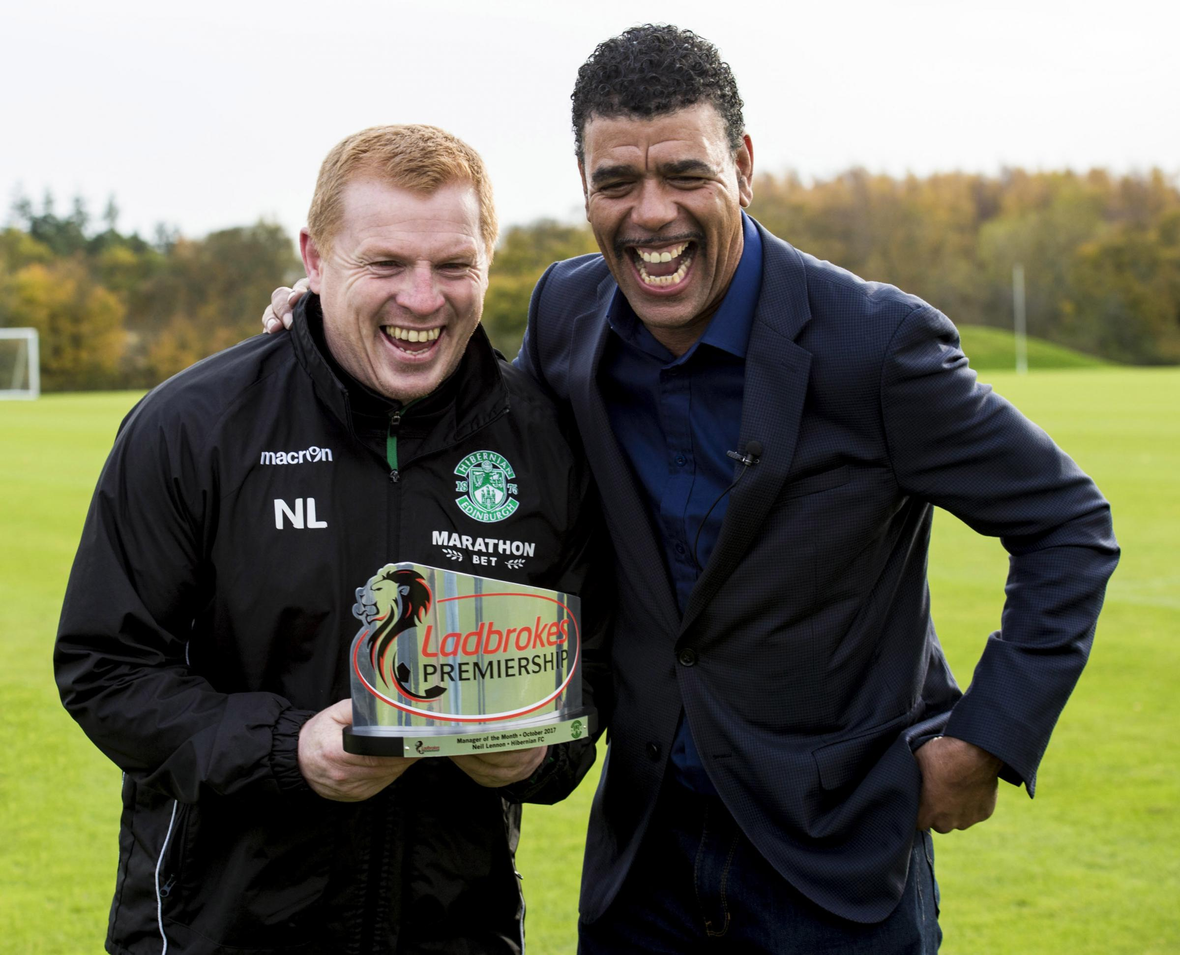 Hibernian manager Neil Lennon shares a joke with Chris Kamara as he is presented with the Ladbrokes Premiership Manager of the Month award