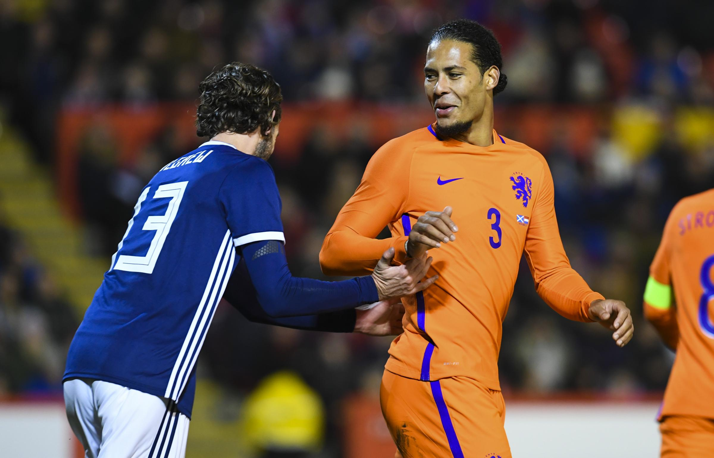 Scotland's Charlie Mulgrew (left) with former Celtic team-mate Virgil Van Dijk