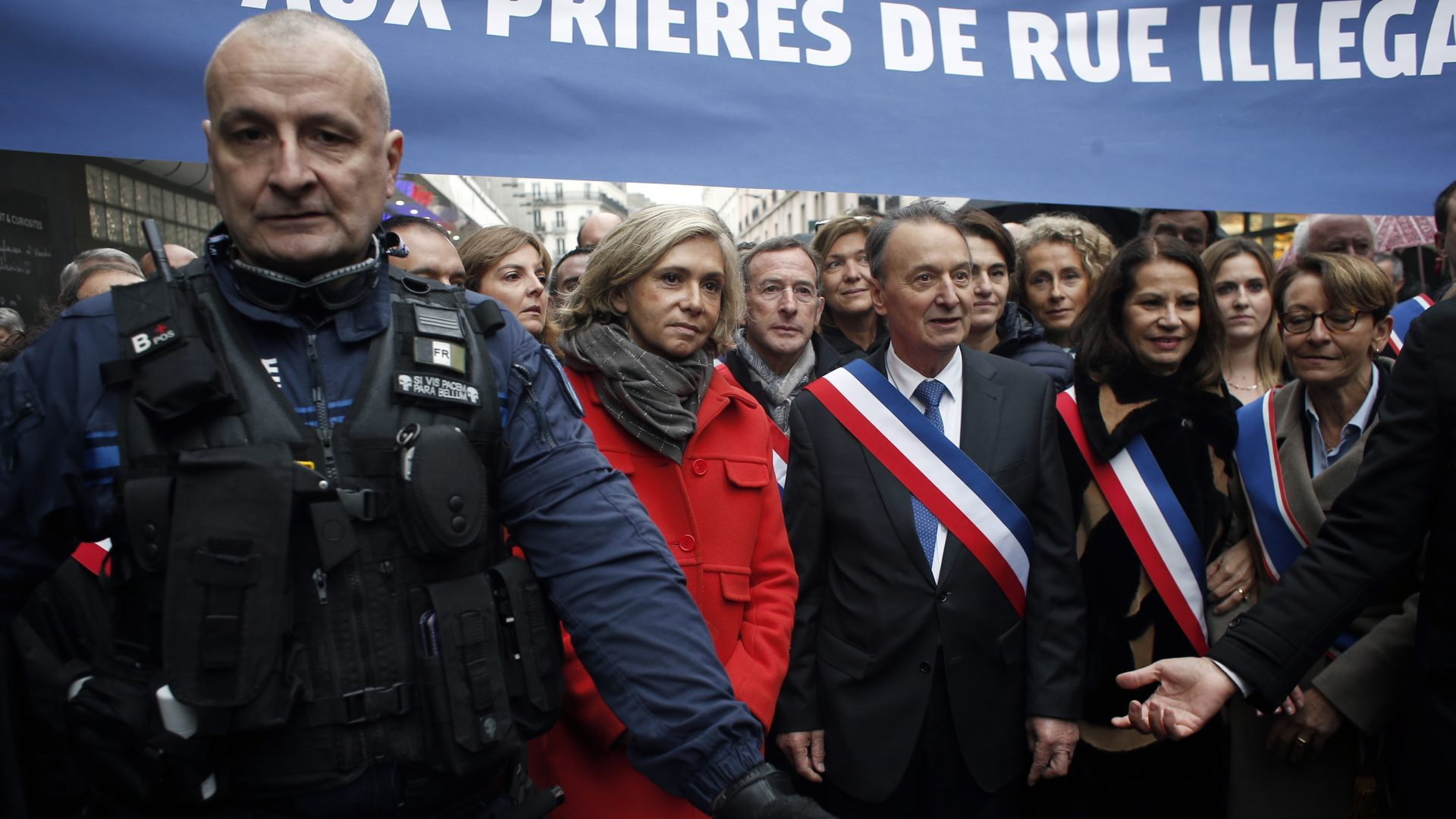 Clichy la Garenne's mayor Remi Muzueau, centre right, and President of the Regional Council of the Ile-de-France region Valerie Pecresse, centre left, demonstrate against Muslim street prayers, in the Paris suburb of Clichy la Garenne