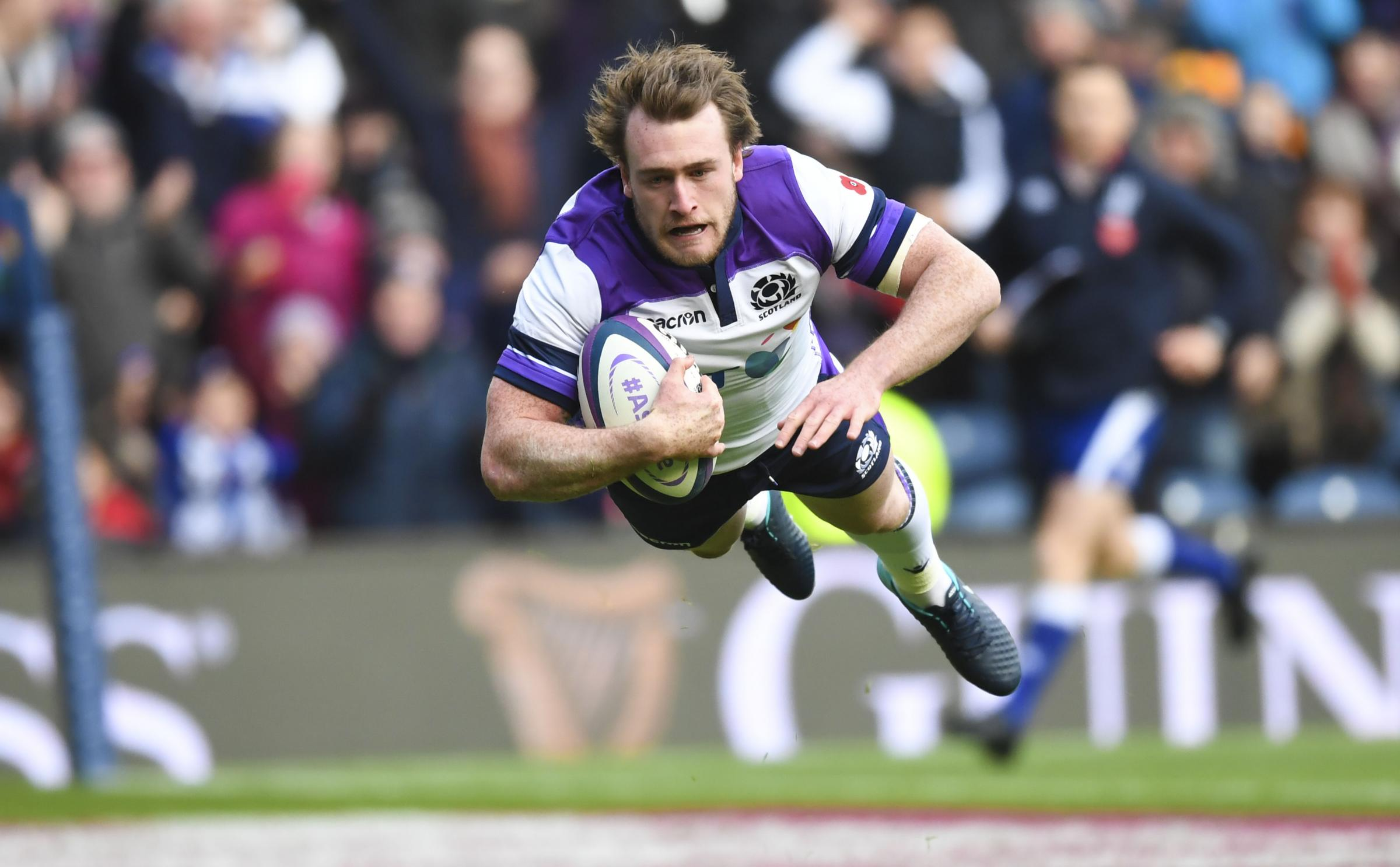 Stuart Hogg flies through the air for the 17th try of his Scotland career