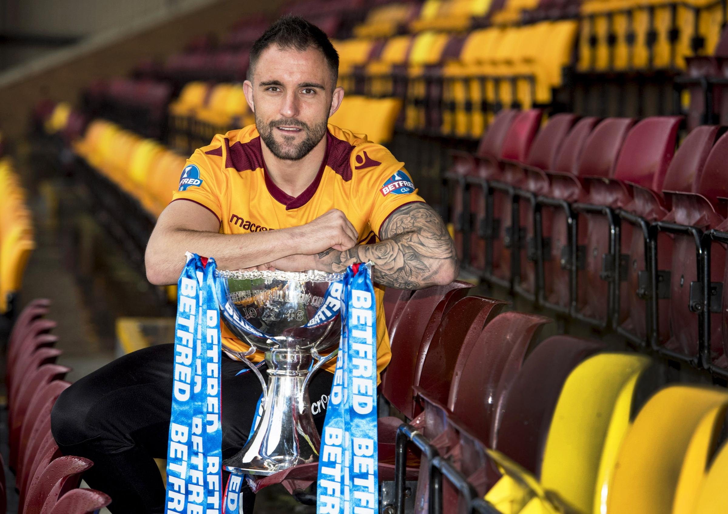 Motherwell defender Peter Hartley with the Betfred Cup trophy at Fir Park yesterday.