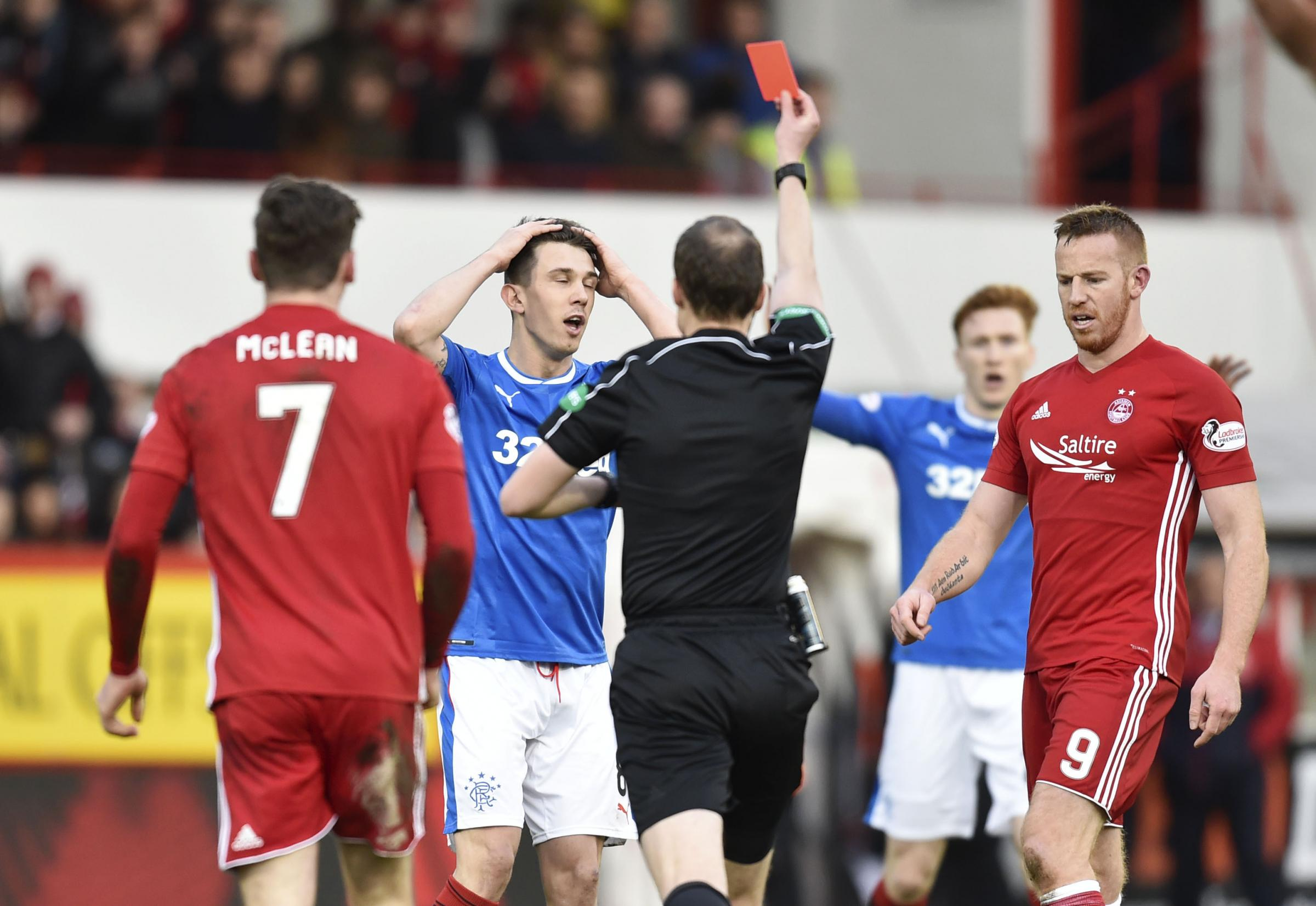 Ryan Jack (centre) is shown a red card by referee Willie Collum