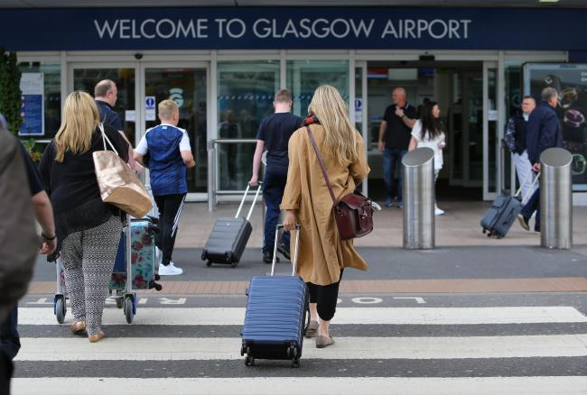 Start of Glasgow fair fortnight. Pictured are passengers arriving at Glasgow airport...   Photograph by Colin Mearns.14 July 2017..