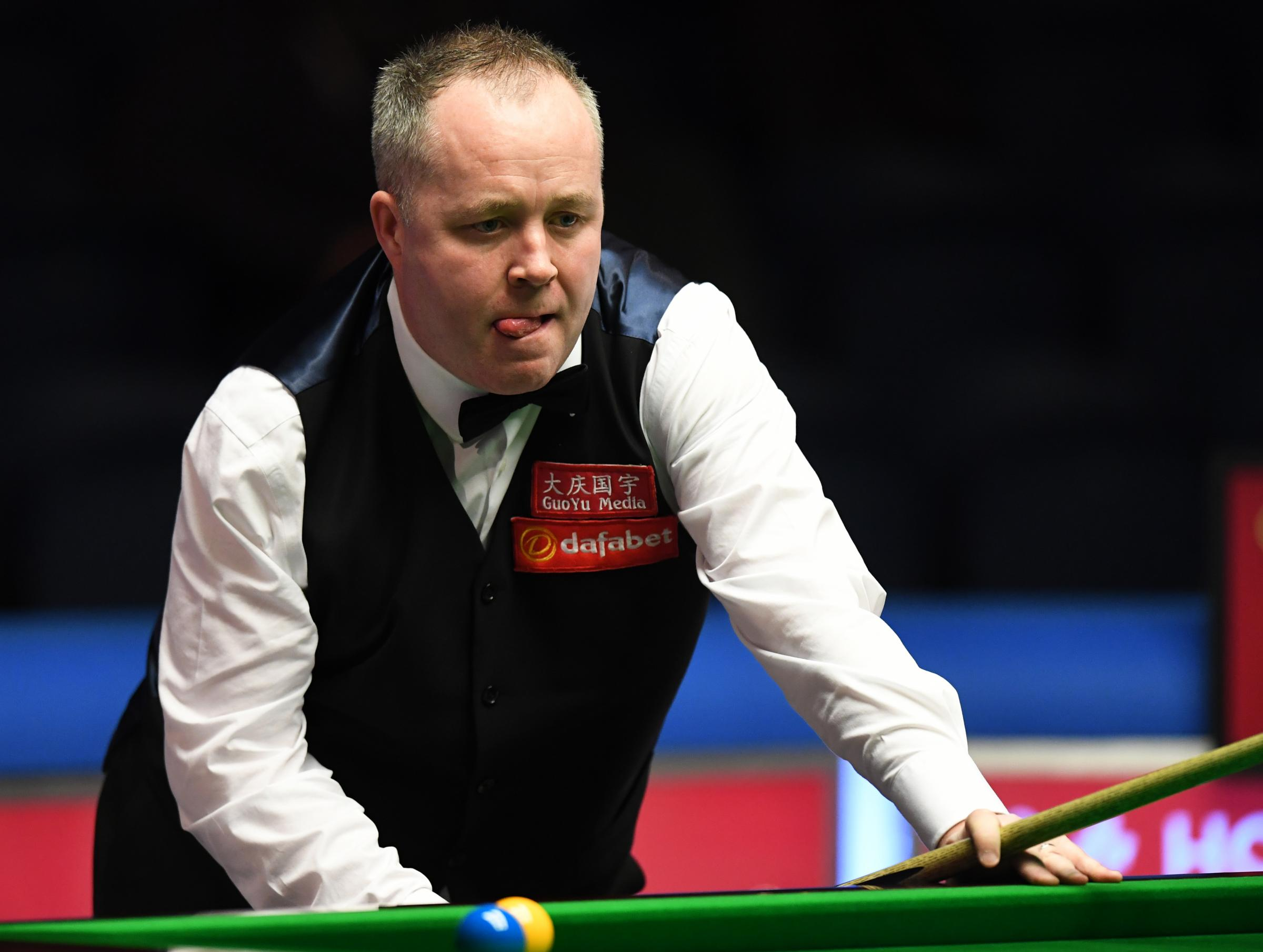 John Higgins continued on from Monday's first-round victory