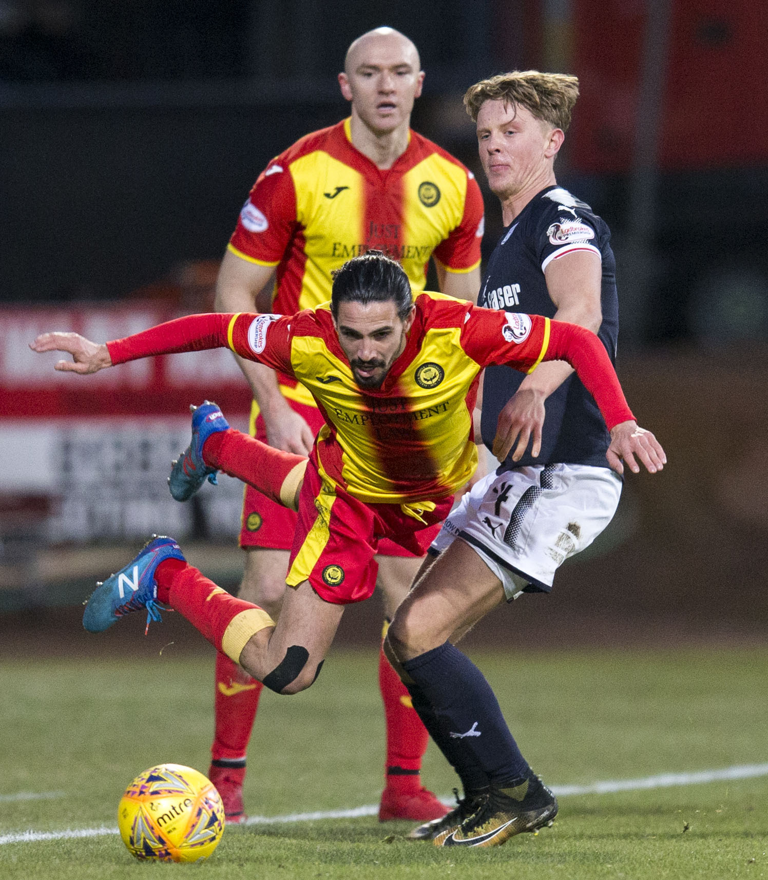 Down and out at Dens: Partick Thistle's Ryan Edwards takes a tumble in the loss at Dundee (Picture: SNS)