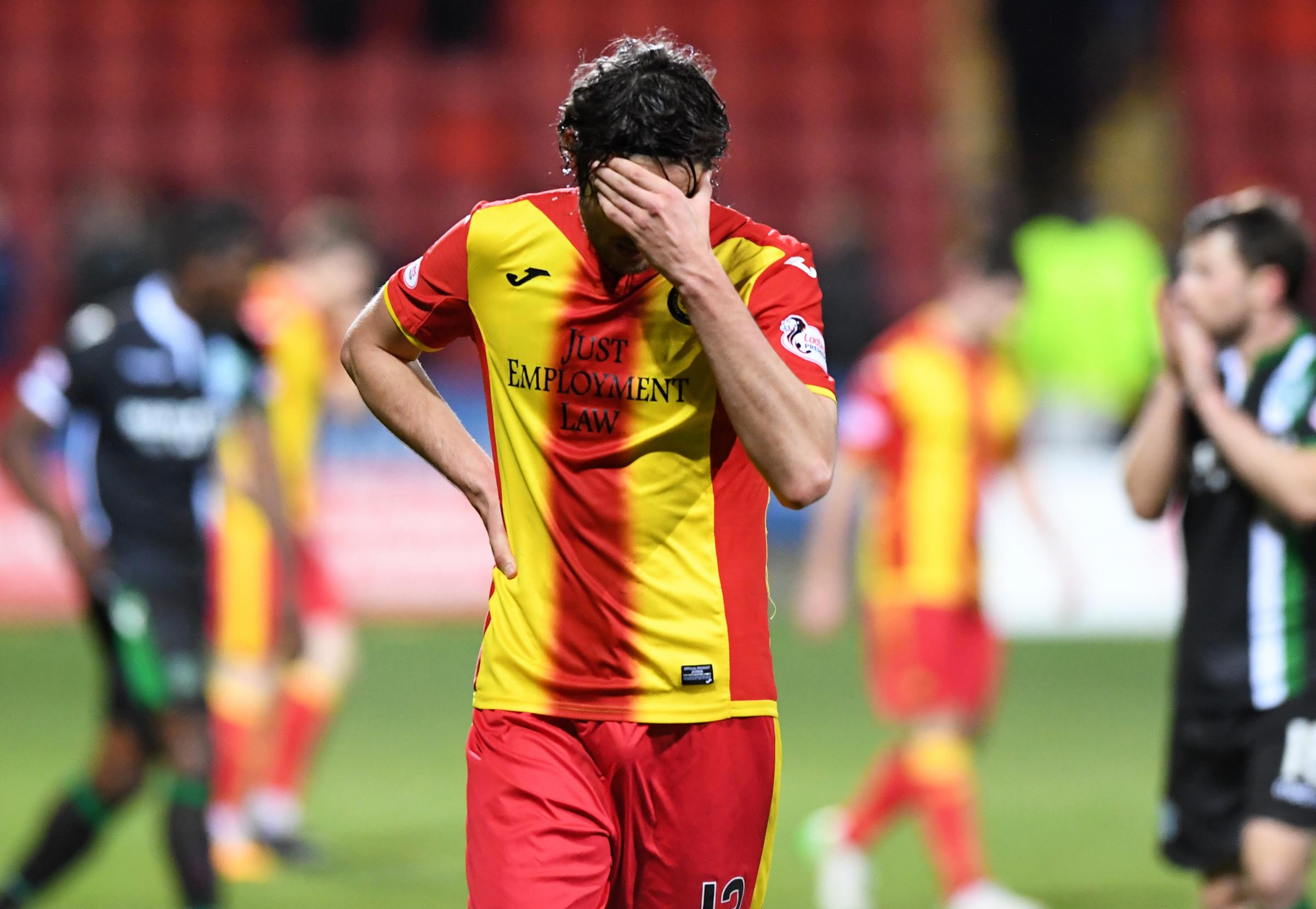 Down and out: Adam Barton's reaction to defeat at Dundee sums up Partick Thistle's mood (Picture: SNS)