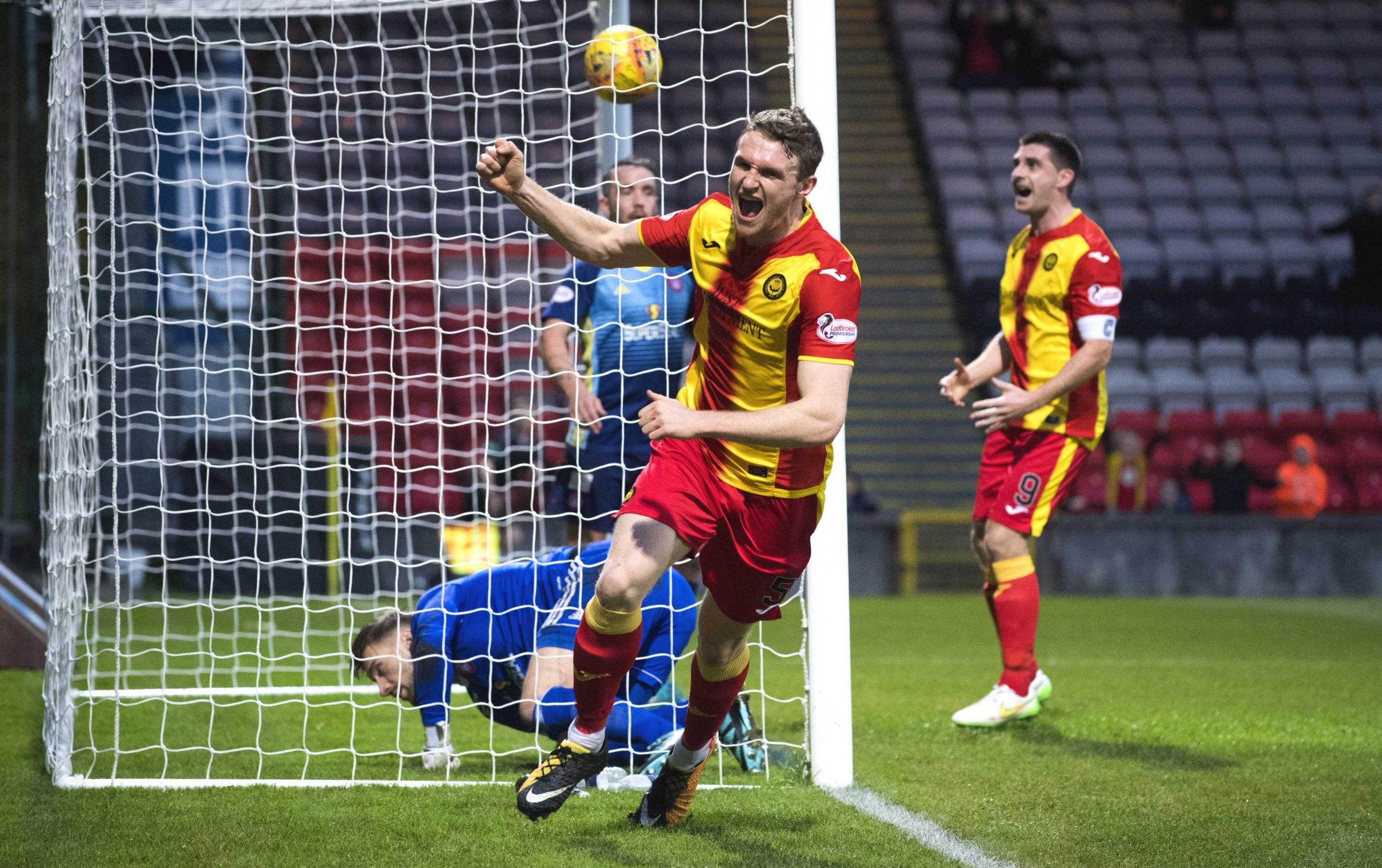 Get in: Niall Keown celebrates his winner for Partick Thistle against Hamilton (Picture: SNS)
