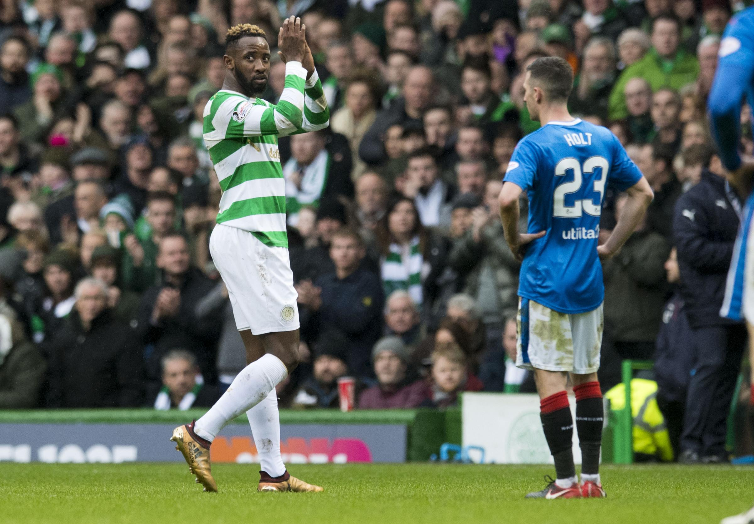 Moussa Dembele applauds the Celtic support as he leaves the filed during Saturday's 0-0 draw with Rangers