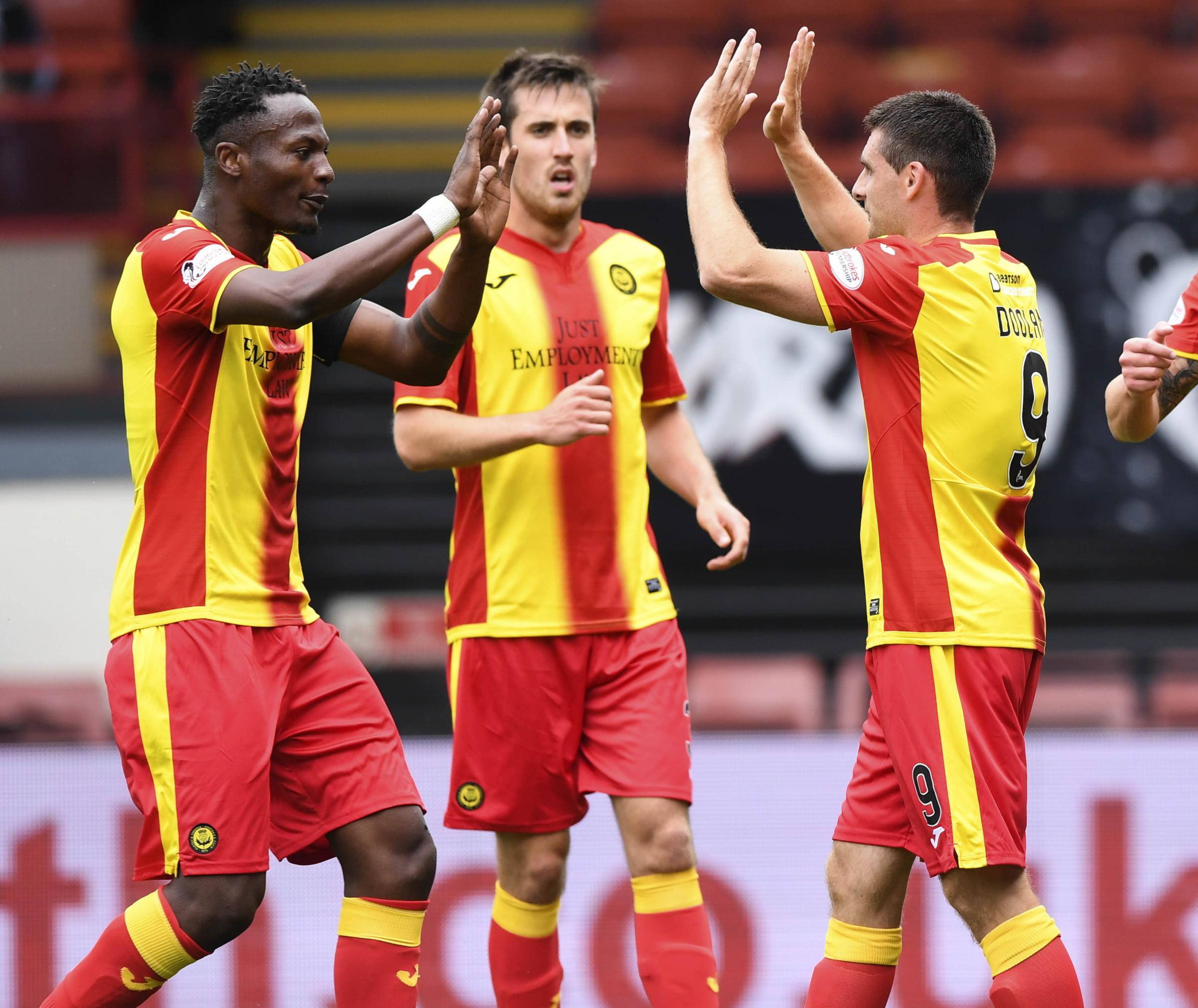 Abdul Osman (left) and Callum Booth (centre) both made their return from injury in Partick Thistle's win over Shanghai Shenhua.