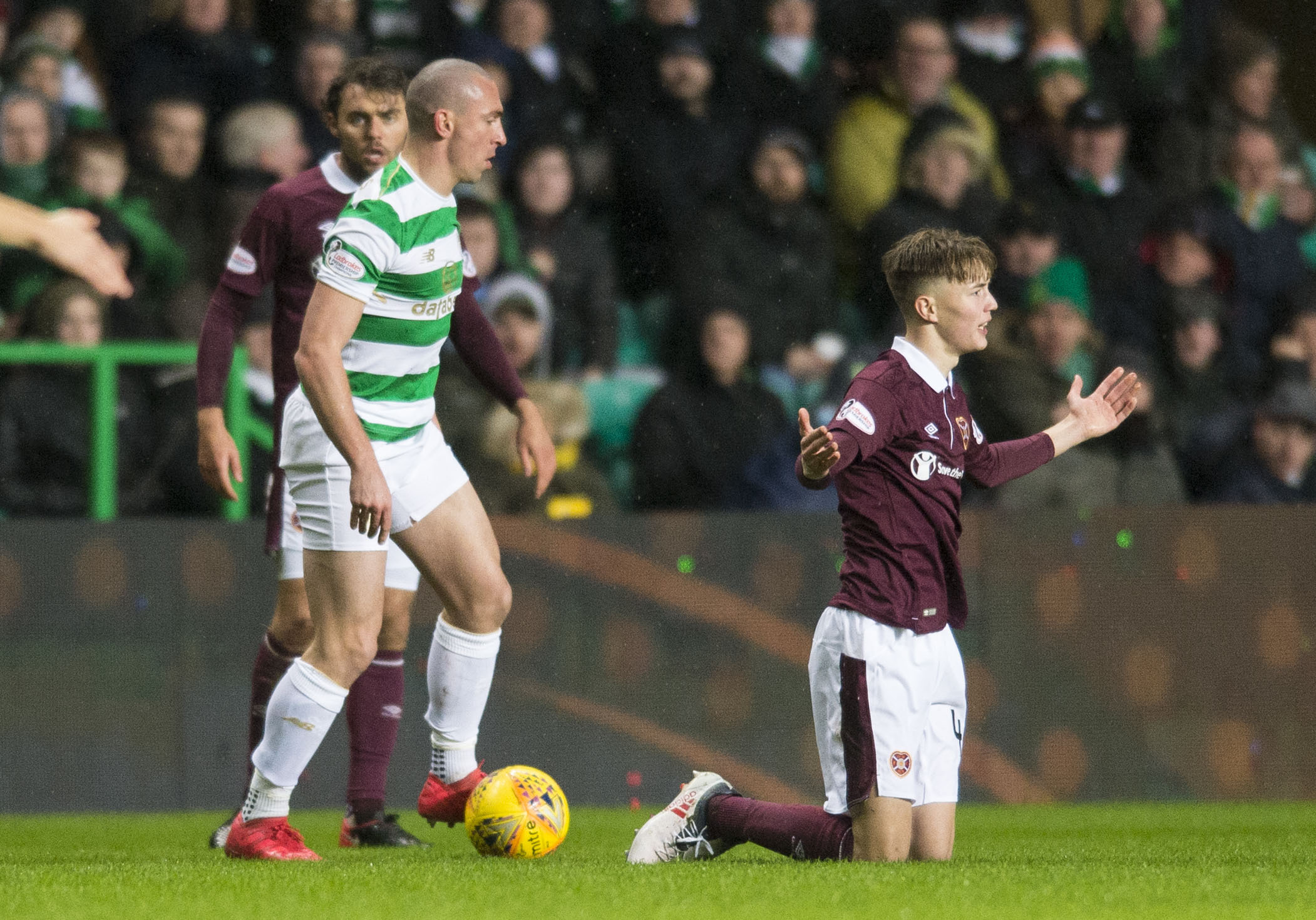 Celtic captain Scott Brown, left, and Hearts midfielder Harry Cochrane at Parkhead on Wednesday night.
