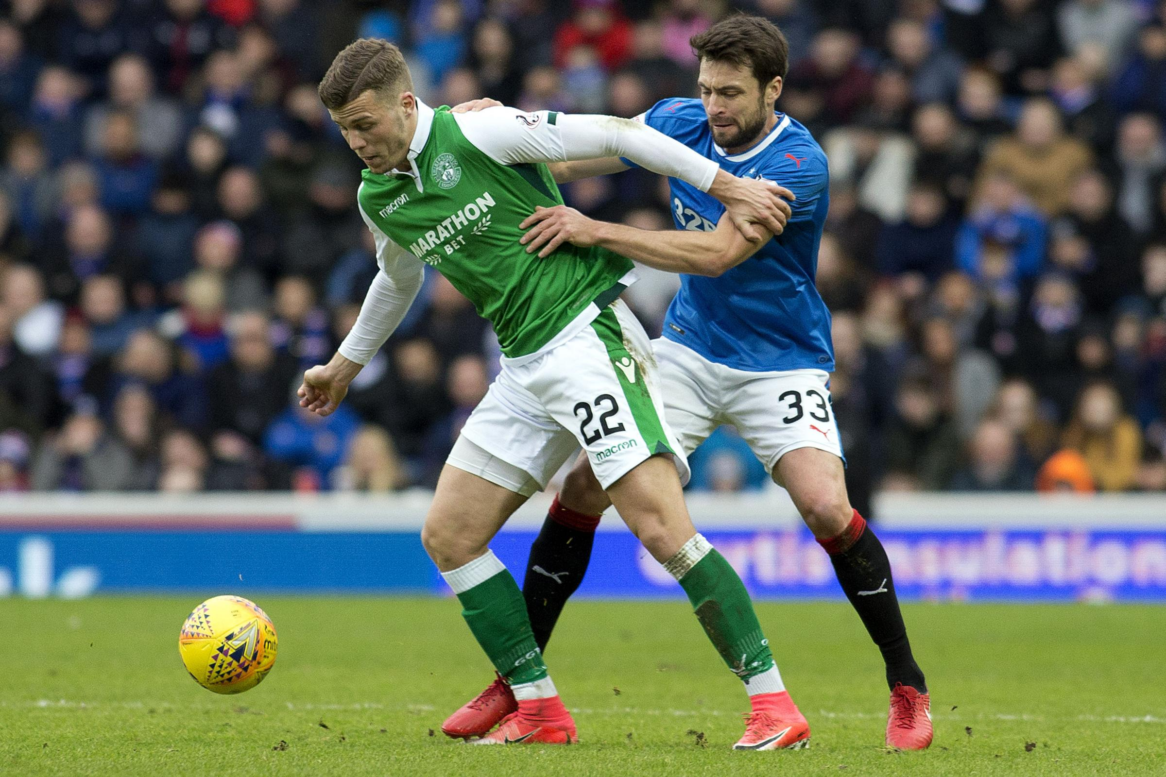 Rangers' Russell Martin (right) and Hibernian's Florian Kamberi battle for the ball
