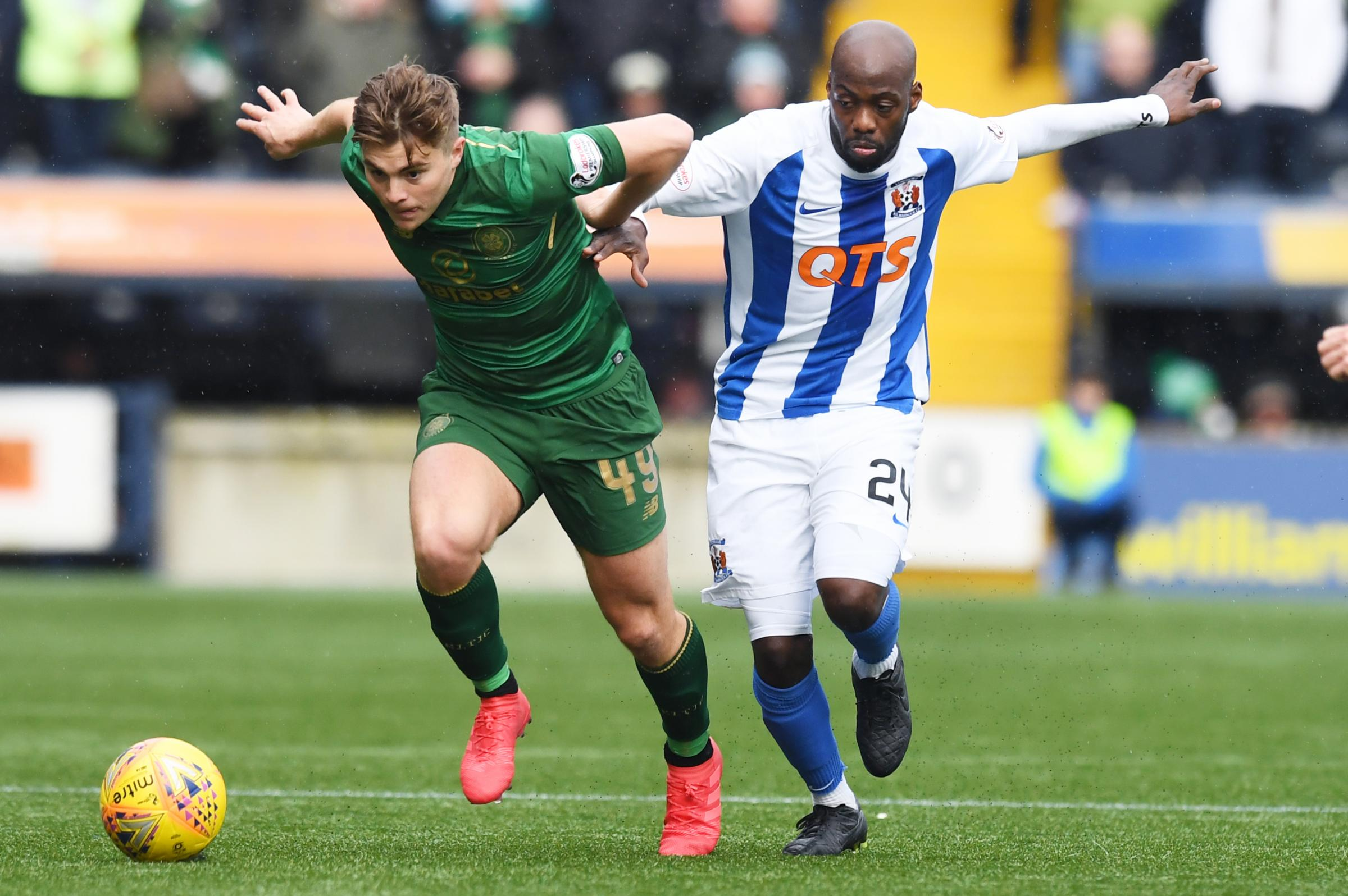 Celtic's James Forrest in action with Kilmarnock's Youssouf Mulumbu. Picture: SNS