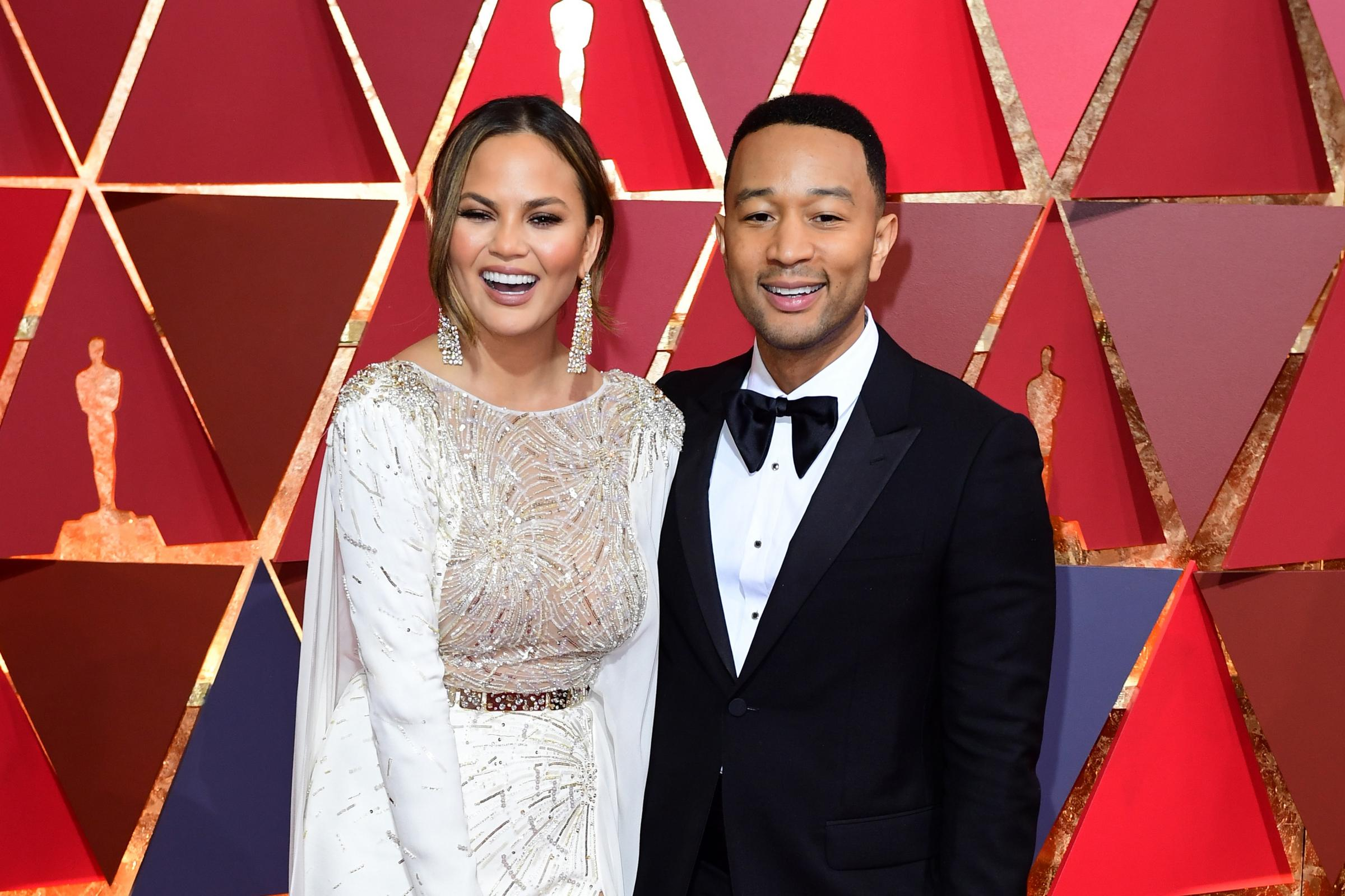 Chrissy Teigen and John Legend (Ian West/PA)