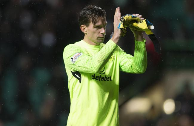 Celtic keeper Dorus de Vries applauds the Parkhead fans.