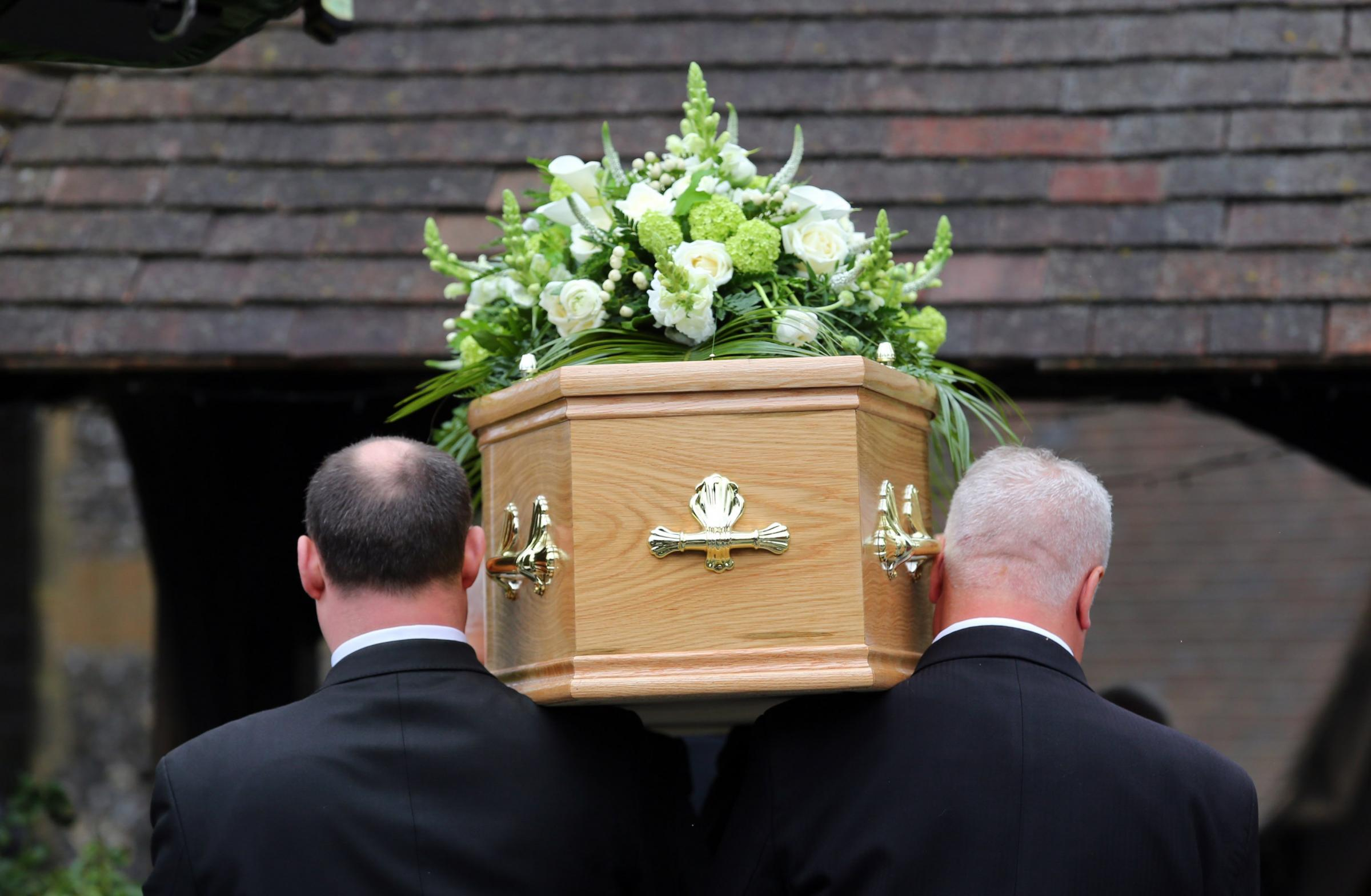 Ronnie Corbett's coffin is carried in to St John the Evangelist Church, near the late comedian's home in Shirley, Croydon, south London, for his funeral.