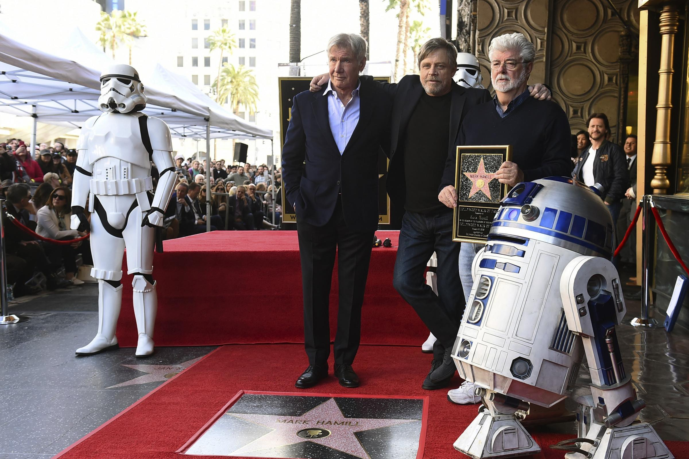 Mark Hamill with fellow Star Wars cast member Harrison Ford and creator George Lucas (Jordan Strauss/Invision/AP)