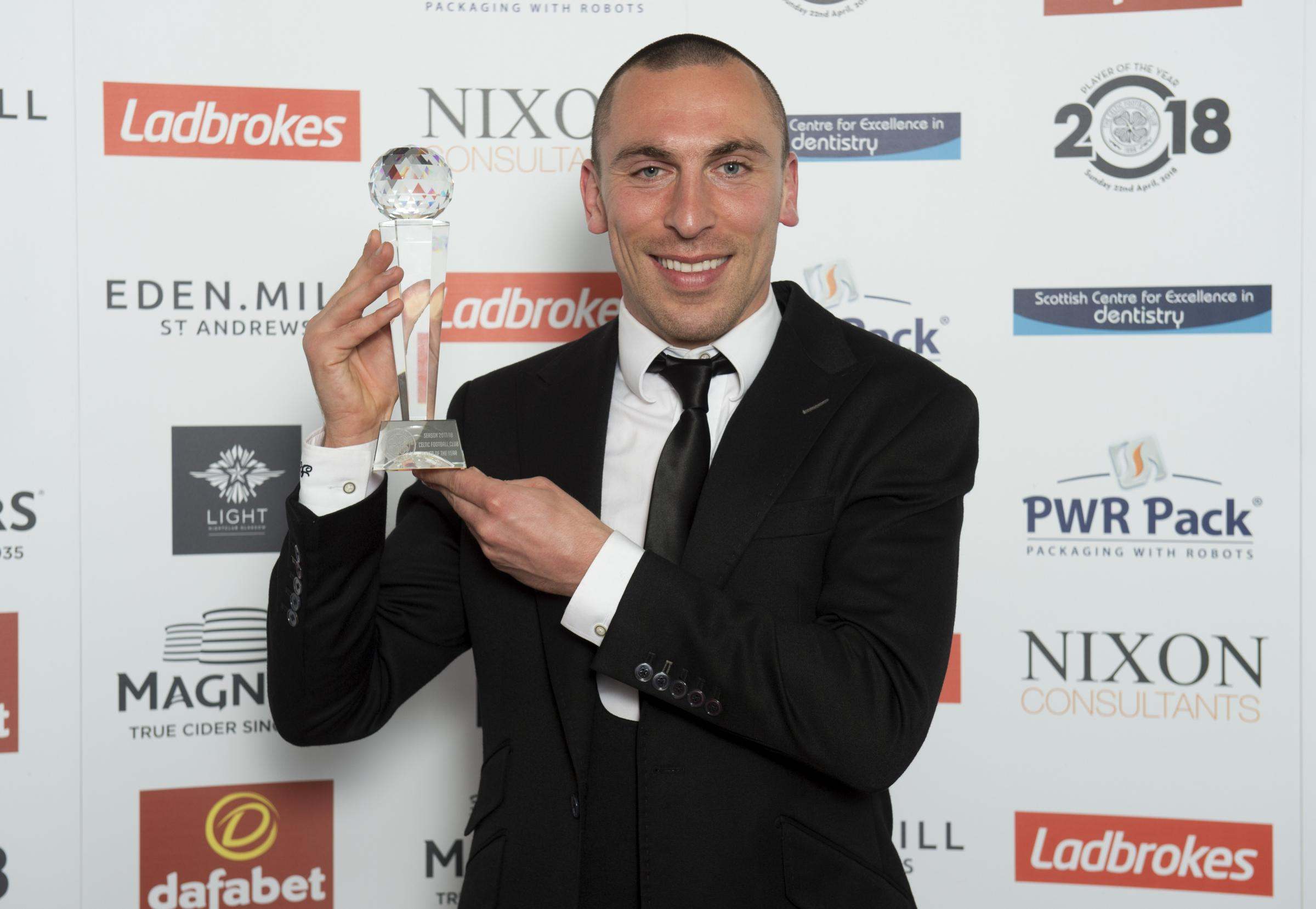 Celtic captain Scott Brown collects the Player of the Year award at the club's annual dinner