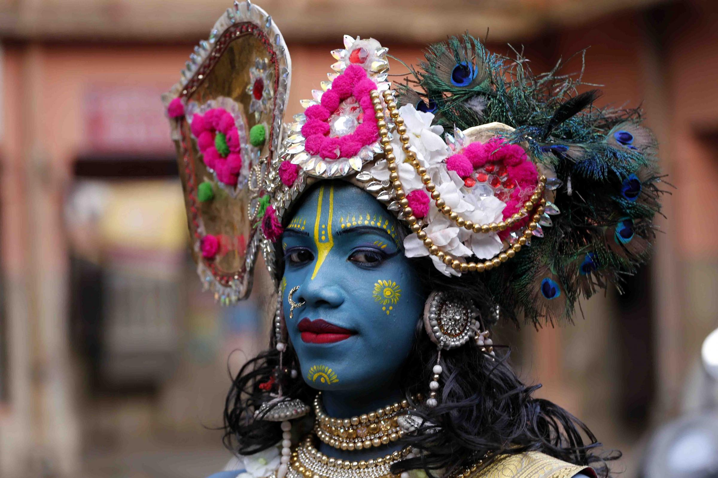 An Indian devotee dressed as the Hindu deity Lord Krishna poses during Shyam Baba festival in Ajmer in the Indian state of Rajasthan on April 26, 2018. (Photo by HIMANSHU SHARMA / AFP)