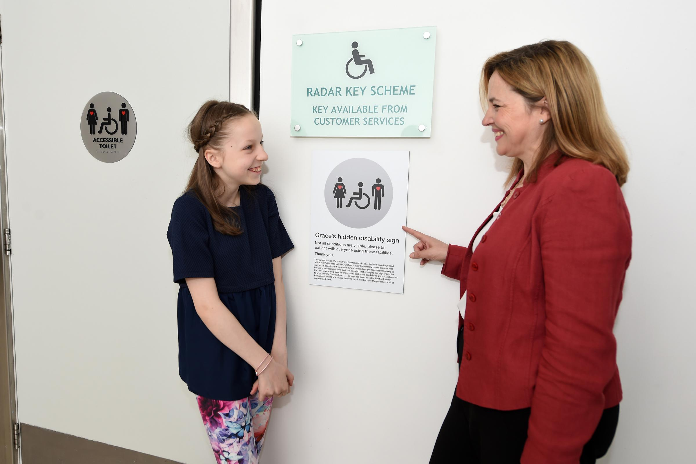 Grace Warnock celebrates the installation of her sign at St Enoch Centre, with general manager Anne Ledgerwood.