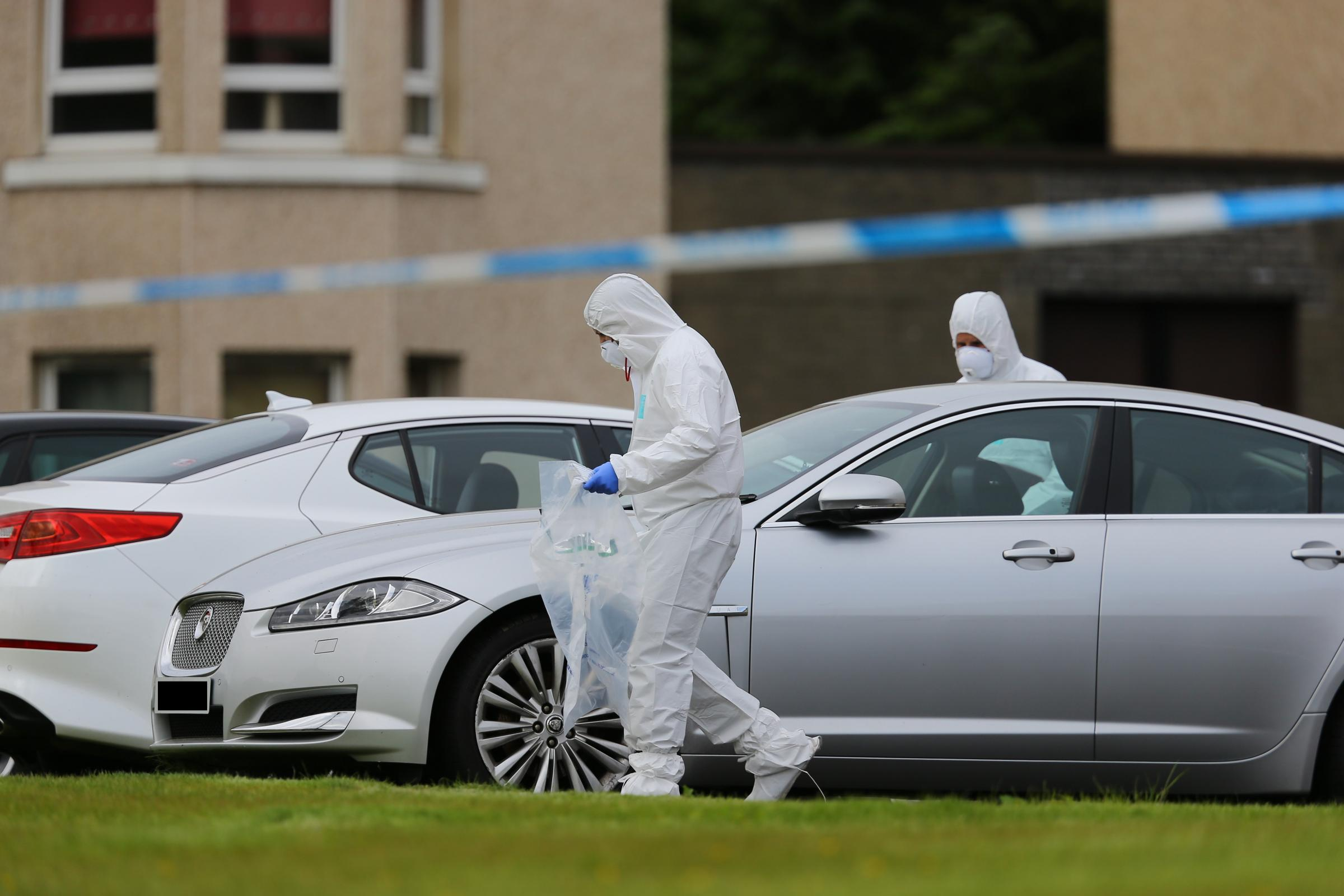 Police attending the aftermath of an incident at Kingsway Court, Scotstoun, Glasgow. A wrecked car on the grass in front of the flats...   Photograph by Colin Mearns.21 May 2018..