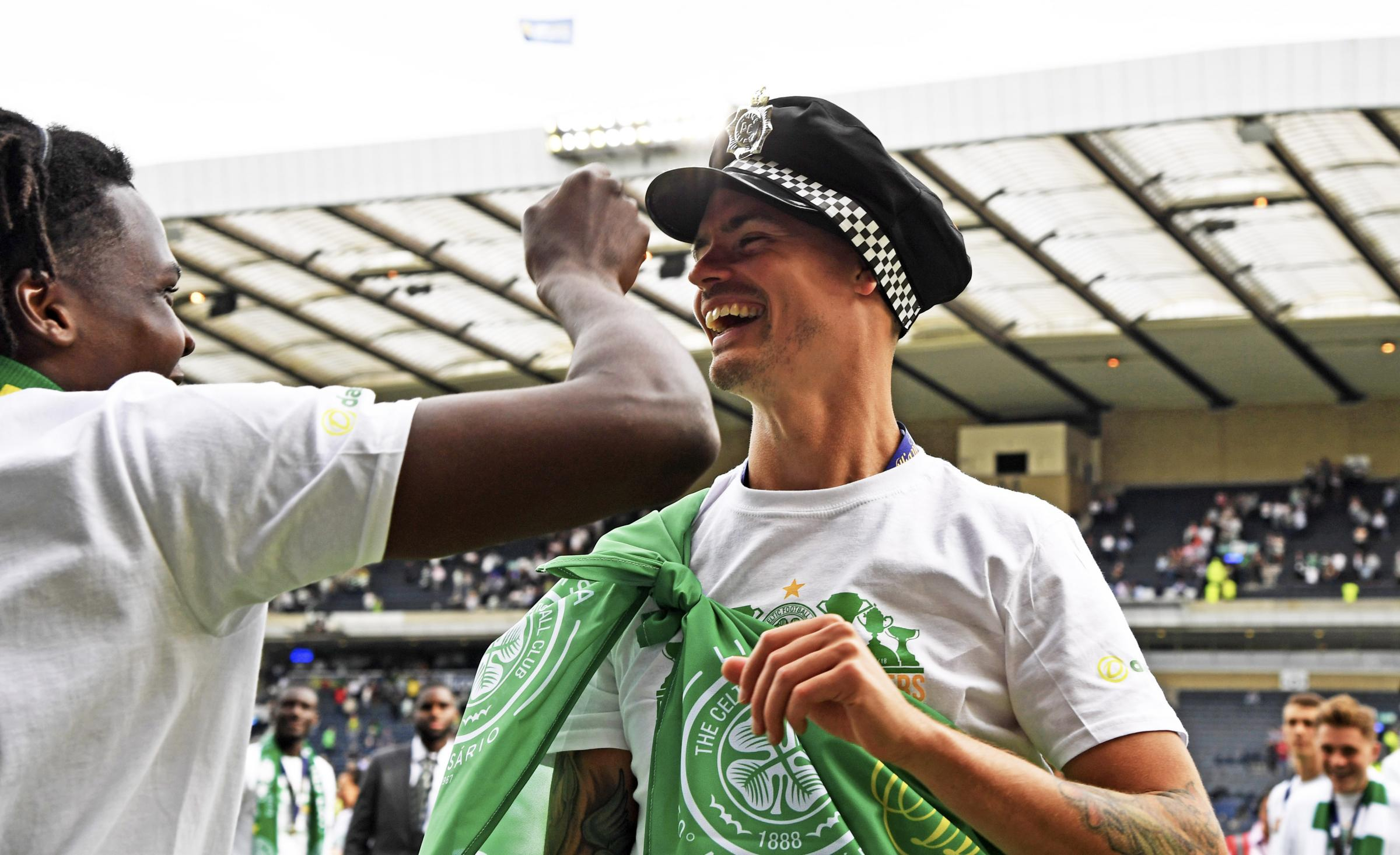 Celtic's Mikael Lustig celebrates with a Police Hat..